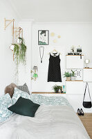 Decorative modular furniture on wall behind bed