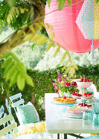 Lanterns hung above set garden table