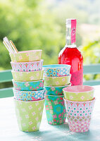 Colourful party beakers on garden table