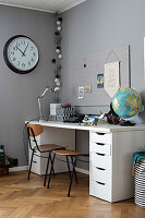Desk with drawers in boy's room in shades of grey