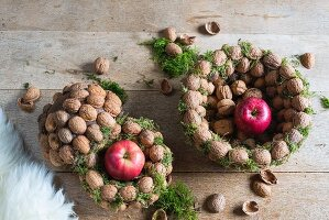Walnuts and apples in baskets made from threaded walnuts (Christmas arrangement)