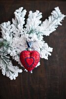Christmas arrangement of red love-heart and snowy branches