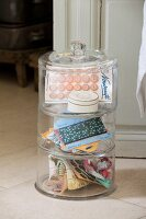 Buttons and ribbons in vintage-style stacking glass jars