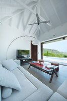 View from sofa onto terrace through panoramic window