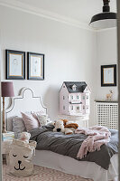Dolls' house in elegant, French-style child's bedroom