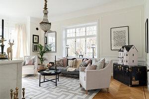 Vintage accessories in elegant living room in pastel shades