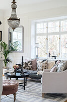 Elegant living room in pastel shades with chandelier