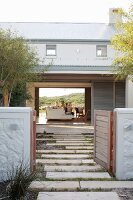 Architect-designed house with open garden gate and open façade