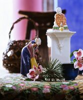 China figurines, pine sprig and Peruvian lilies