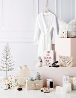 Feminine Christmas gift ideas in front of white wall