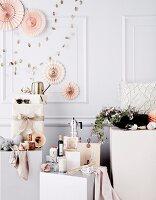 Gift ideas arranged on white plinths
