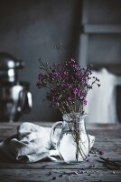 Flowers in water in a country kitchen