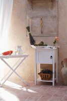 Summer atmosphere: fruit, drinks and flowers on tray table and cabinet in Mediterranean room