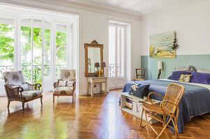 Large bedroom with floor-to-ceiling windows and herringbone parquet floor