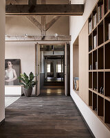 Custom-made, fitted shelving in loft-apartment interior