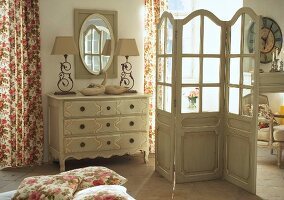 Chest of drawers and screen in romantic bedroom
