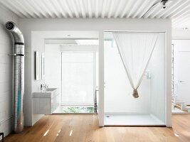 Sink and shower in mezzanine bathroom
