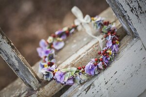 Floral wreath in weathered window frame