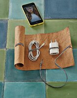 A DIY roll-up cable bag made of leather paper