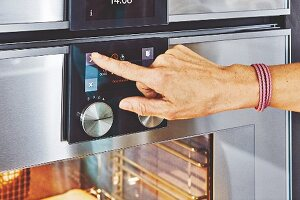 The control panel of an all-in-one kitchen appliance with oven, steamer and warming drawer
