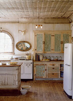 Dresser and retro fridge in shabby-chic kitchen