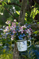 Small bouquet made of malus (apple) branches and myosotis