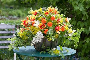 Lush arrangement with tulipa (tulip), geum (clove), syringa