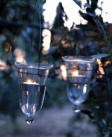 Glass tealight holders hung in tree