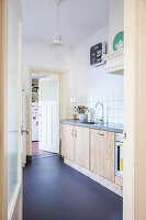 Bright kitchen with dark floor