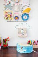 Postcard rack on wall above desk