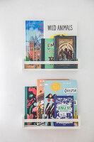 Books on flat-front bookshelves