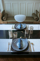 Table elegantly set with gold accessories
