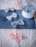 Garland with tissue paper bows on stone platter