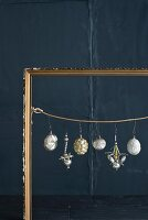 Old Christmas decorations in gilt picture frame