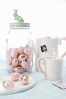 Pink and gold sugar eggs, teacup and teapot
