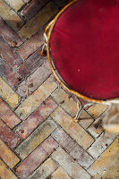 Herringbone-patterned brick paving