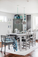 Dining room in shades of grey with blue accents