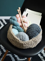 A crocheted basket for wool and embroidery utensils made from string