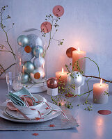 Place setting and Christmas arrangement with lit candles