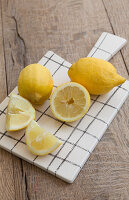 Lemons on cutting board