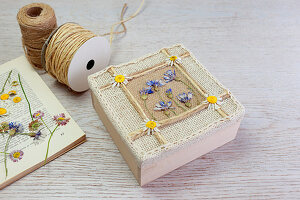 Box decorated with pressed flowers and ribbon