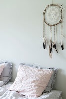 Dreamcatcher handmade from doily above bed