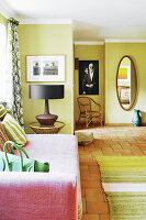 Pink sofa in green living room