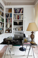 Bookshelves and designer desk in small study