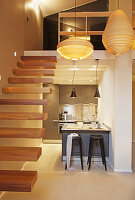 Small kitchen below mezzanine and staircase