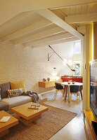 Open-plan interior with brick wall and suspended ceiing