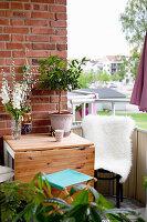 Folding table against brick wall on balcony