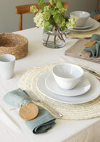 Table set in natural shades with wooden discs on napkin rings