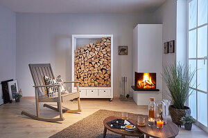 DIY firewood rack next to open fireplace