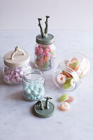 Storage jars with recycled toys decorating lids